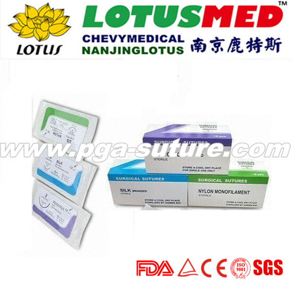 Surgical polyglycolic acid suture reel